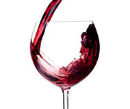 Wine collection - Red wine is poured into a glass Royalty Free Stock Photos