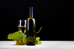 Wine collection: White wine bottle, glass and grapes Royalty Free Stock Photography
