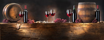 Wine composition. With wine cask on background