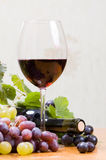 Wine composition. With bottle and glass of wine and bunch of grapes Stock Images
