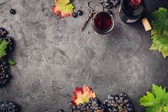 Wine composition on dark rustic background Royalty Free Stock Images