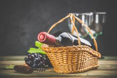 Wine composition on dark rustic background, space for text stock photography
