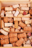 Wine corcks collection in wooden box. Royalty Free Stock Photo