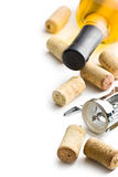 Wine cork, corkscrew and bottle of white wine Stock Image