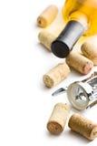 Wine cork, corkscrew and bottle of white wine Stock Image