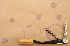 Wine Cork, Corkscrew and red wine stains. On the paper Stock Images