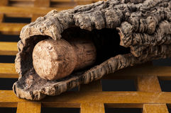 Wine cork in a corkwood bark. Over wooden table Royalty Free Stock Photo