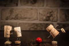 Wine cork figures, Concept Bowling Stock Photo