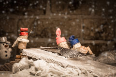 Wine cork figures, Concept children sledging Stock Photography