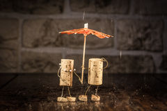 Wine cork figures, Concept Couple in the rain Royalty Free Stock Image