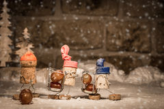 Wine cork figures, Concept Harvester with icewine grapes Royalty Free Stock Photo
