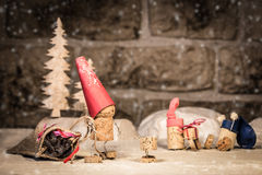 Wine cork figures, Concept Santa and Children in the Snow Royalty Free Stock Photography