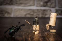 Wine cork figures, Concept Spider and bravery Knight. Concept bravery Knight with Spider, wine cork figures Royalty Free Stock Images