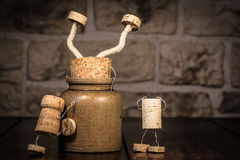 Wine cork figures, Concept sticking in a pot Royalty Free Stock Photo