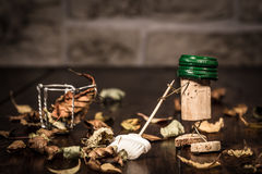 Wine cork figures, Concept sweeping foliage with a broom Stock Images