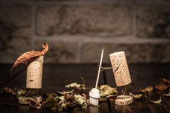 Wine cork figures, Concept two men clean up foliage Stock Photography