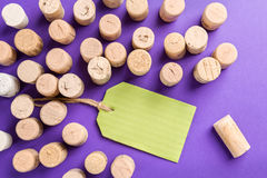 Wine cork stoppers with green label on purple background Royalty Free Stock Photography