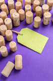 Wine cork stoppers with green label on purple background.Useful Stock Images