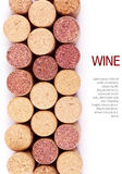 Wine corks. Closeup top view of wine corks over white background Royalty Free Stock Images