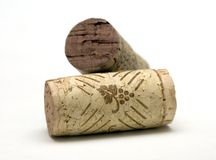 Wine corks. Two discarded wine corks on white Stock Photography