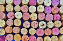 Wine corks arranged in a pattern. Used wine corks arranged in rows and columns as a background Royalty Free Stock Images