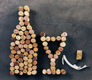 Wine corks arranged in shape of bottle and glass. With corkscrew Royalty Free Stock Photos
