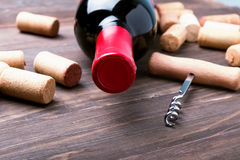 Wine corks and bottle of wine Royalty Free Stock Photography