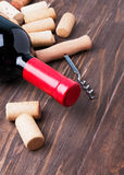 Wine corks and bottle of wine Stock Images