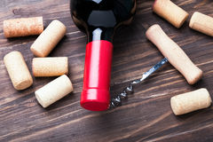 Wine corks and bottle of wine Stock Photos