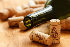 Wine corks and bottle. On wooden table Stock Photo