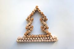 Wine corks Christmas tree silhouette. Isolated on white background from a high angle view stock photography