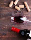 Wine corks, corkscrew and glass with a red wine Royalty Free Stock Image