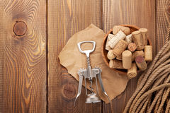 Wine corks and corkscrew over rustic wooden table Royalty Free Stock Image
