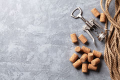 Wine corks and corkscrew. Over stone background. Top view with copy space Royalty Free Stock Images
