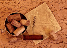 Wine corks and corkscrew on wooden  background Stock Image