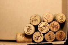 Wine corks with dates on paper background for your greeting text Royalty Free Stock Image