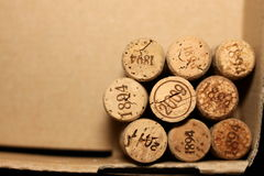 Wine corks with dates in retro style on paper background for your text Royalty Free Stock Image
