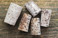 Wine corks. Five old corks on a wooden table Stock Photos