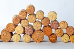 Wine corks flocked at random heights on a white background. royalty free stock photography