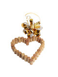 Wine corks in the form of heart and a golden bow Royalty Free Stock Images