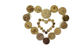 Wine corks form a heart shape image isolated on white background Royalty Free Stock Photos