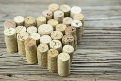 Wine corks form a heart shape on the wood board background Valentine's Day composition Royalty Free Stock Images
