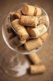 Wine corks in glass Royalty Free Stock Images