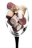 Wine corks in glass isolated Royalty Free Stock Photos