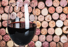 Wine corks through a glass of red Royalty Free Stock Photography