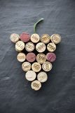 Wine: Corks in grape shape on slate Royalty Free Stock Image