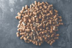 Wine corks grape shape and vine on stone table. Top view with copy space for your text. royalty free stock images