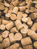 Wine corks. Lots of unbranded wine corks, cork texture. Vertical orientation stock photography