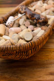 Wine corks in a old basket bread on rosewood timber Stock Image