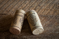 Wine corks on old wooden background Royalty Free Stock Photo